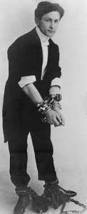 Harry Houdini in handcuffs
