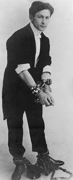 Harry Houdini in handcuffs